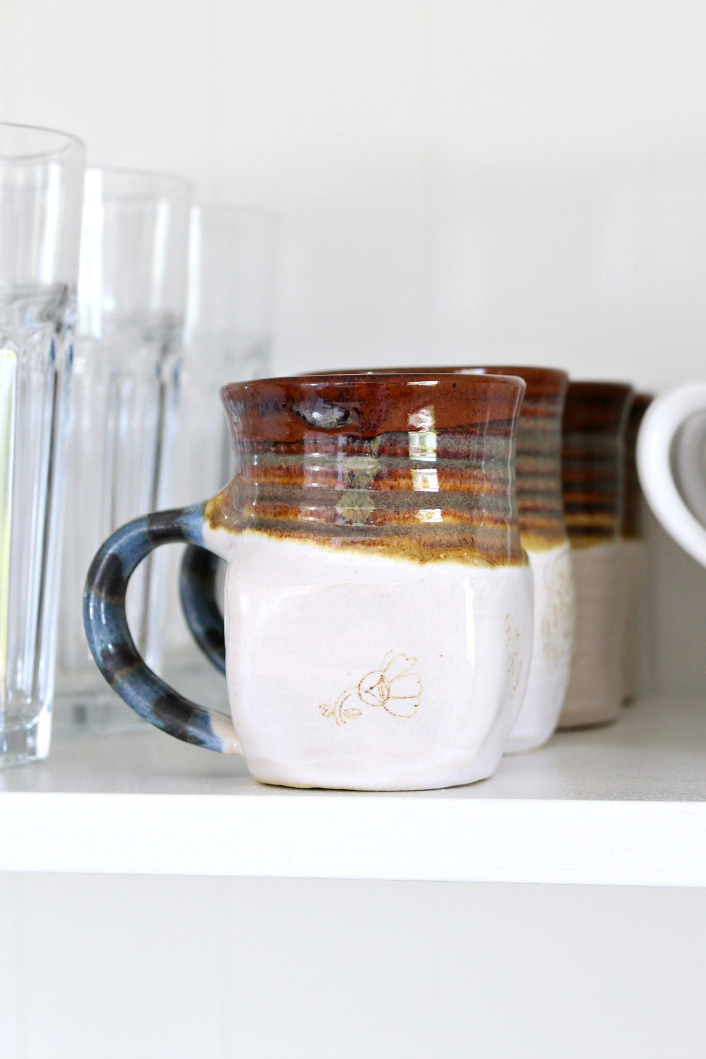 Brown and Blue Pottery Mugs