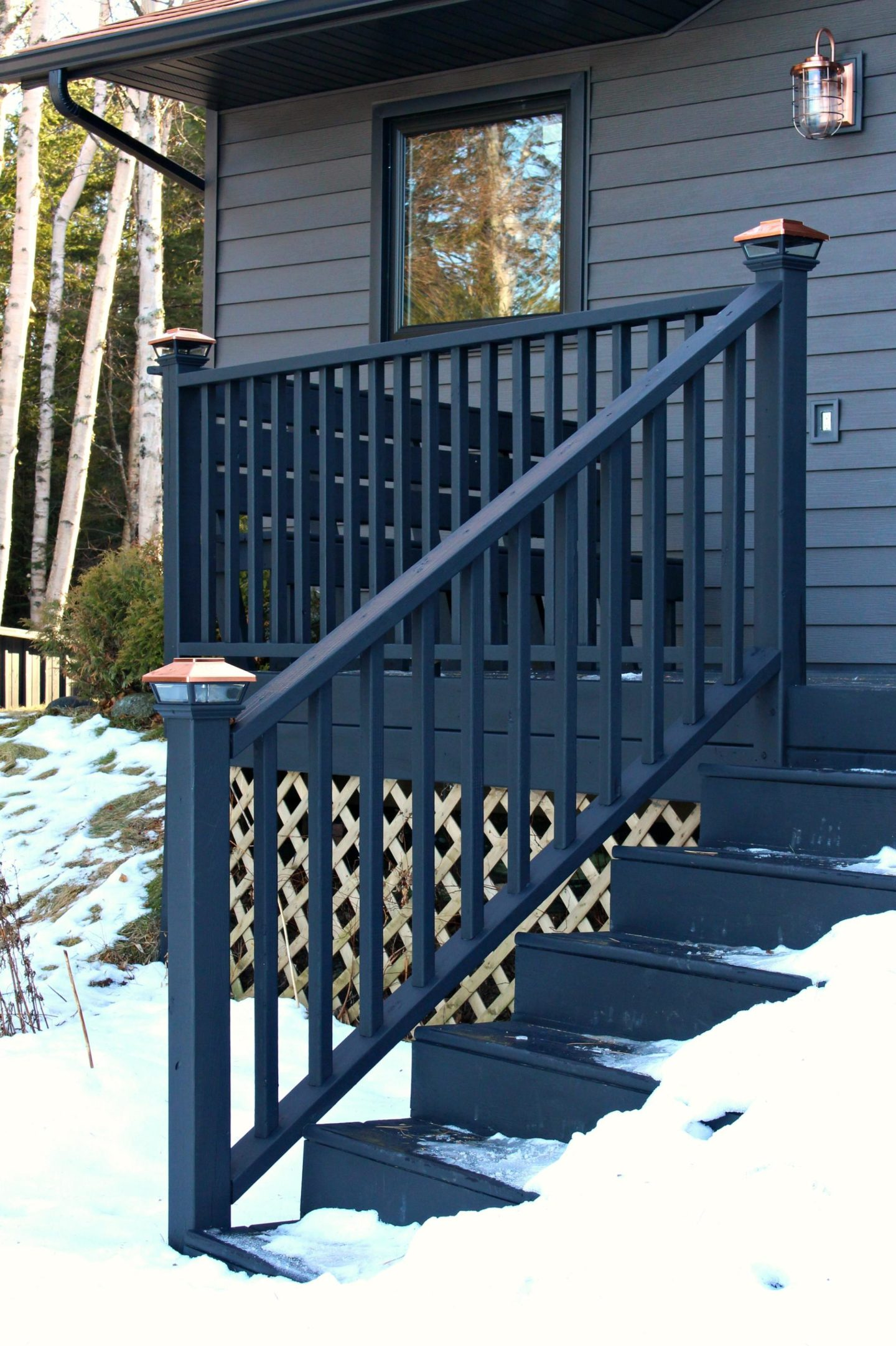 Olympic Black Deck Stain in Mystic Black and Veranda Copper Solar Deck Caps | Staining the Deck Black with Dans le Lakehouse