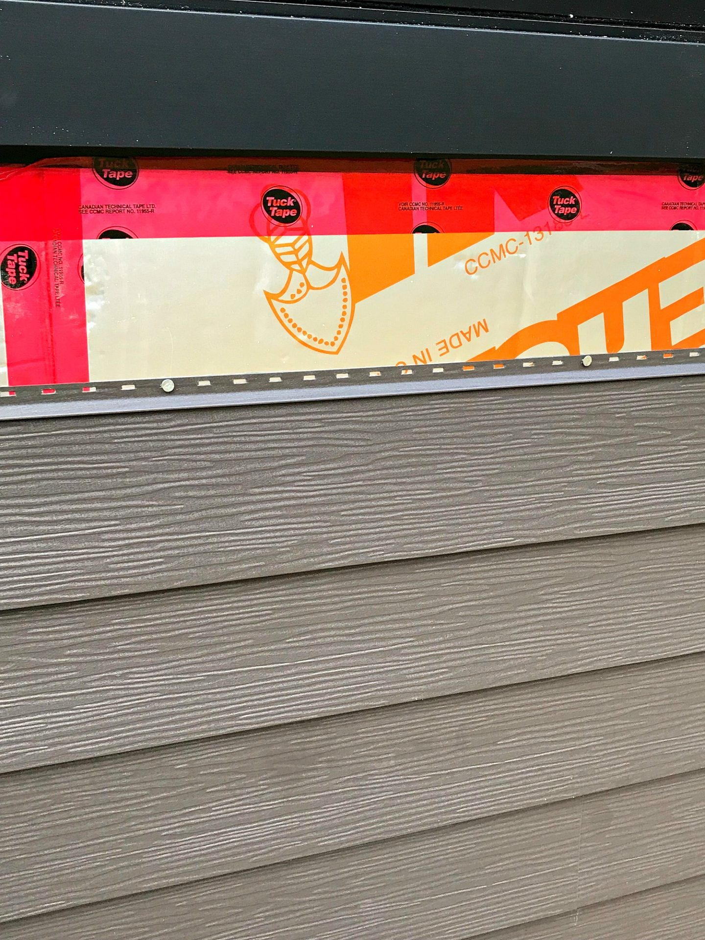 Installation of Dark Grey Metal Siding | Siding That Sparkles!
