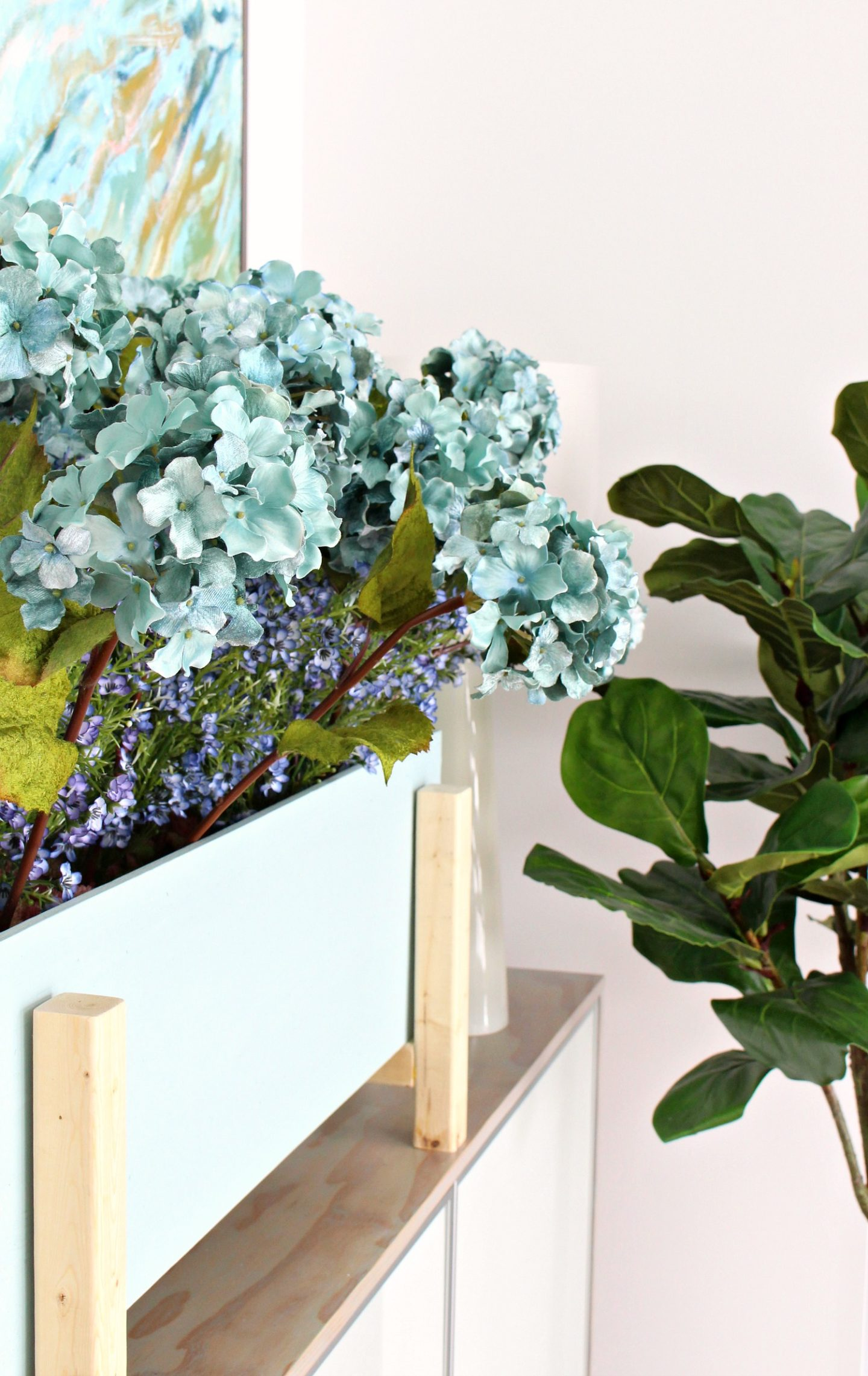 Learn How to Make This Modern DIY Planter Box for Faux Plants with Leftover Plywood and Wood Scraps #diy #homedecor #diyhomedecor #woodworking #plywoodprojects #diyplanter