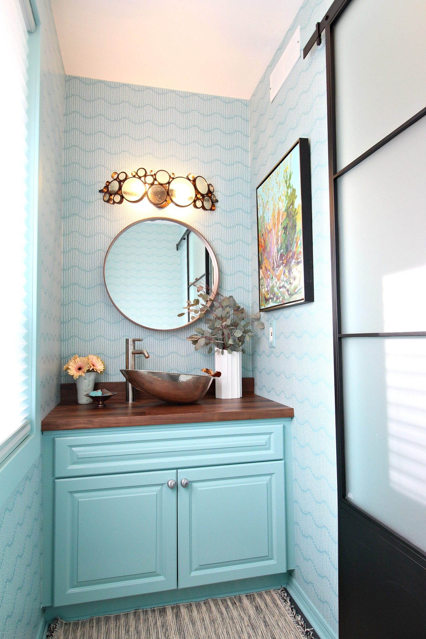 Turquoise Bathroom Makeover with Turquoise Patterned Wallpaper, Matching Turquoise Vanity and Mixed Metals