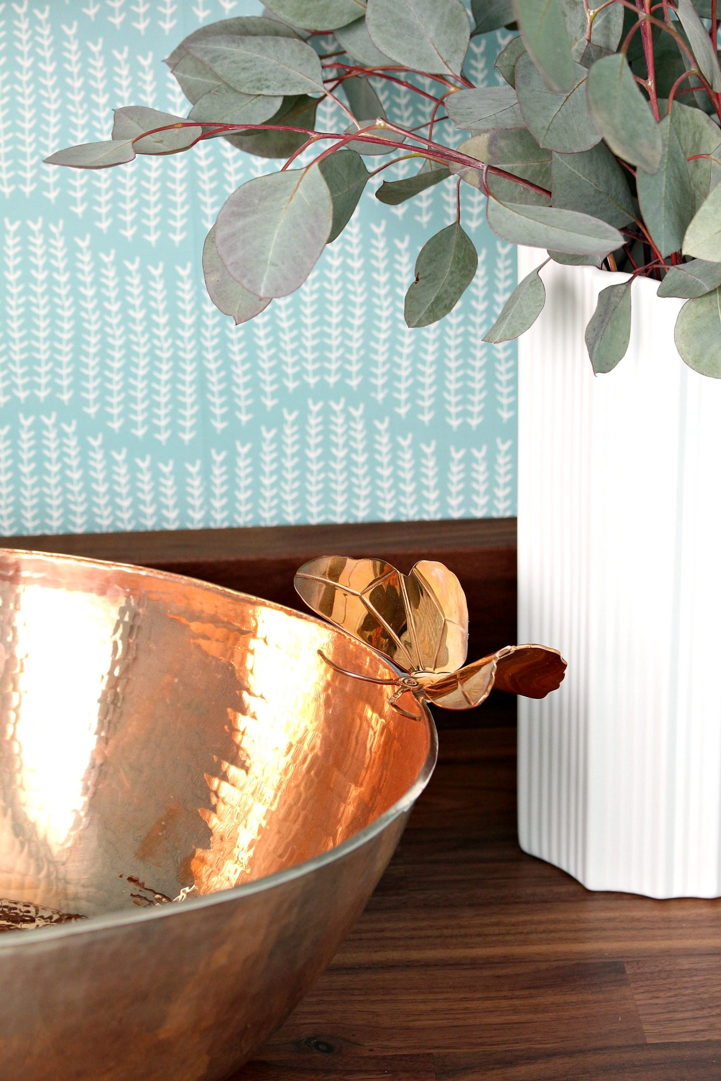 Sink with Butterfly Detail | Turquoise and Copper Powder Room Makeover REVEAL | Handmade Copper Sink, Sprigs on Ocean Wallpaper, Walnut Counters, Colorful DIY Bathroom Makeover Before + After