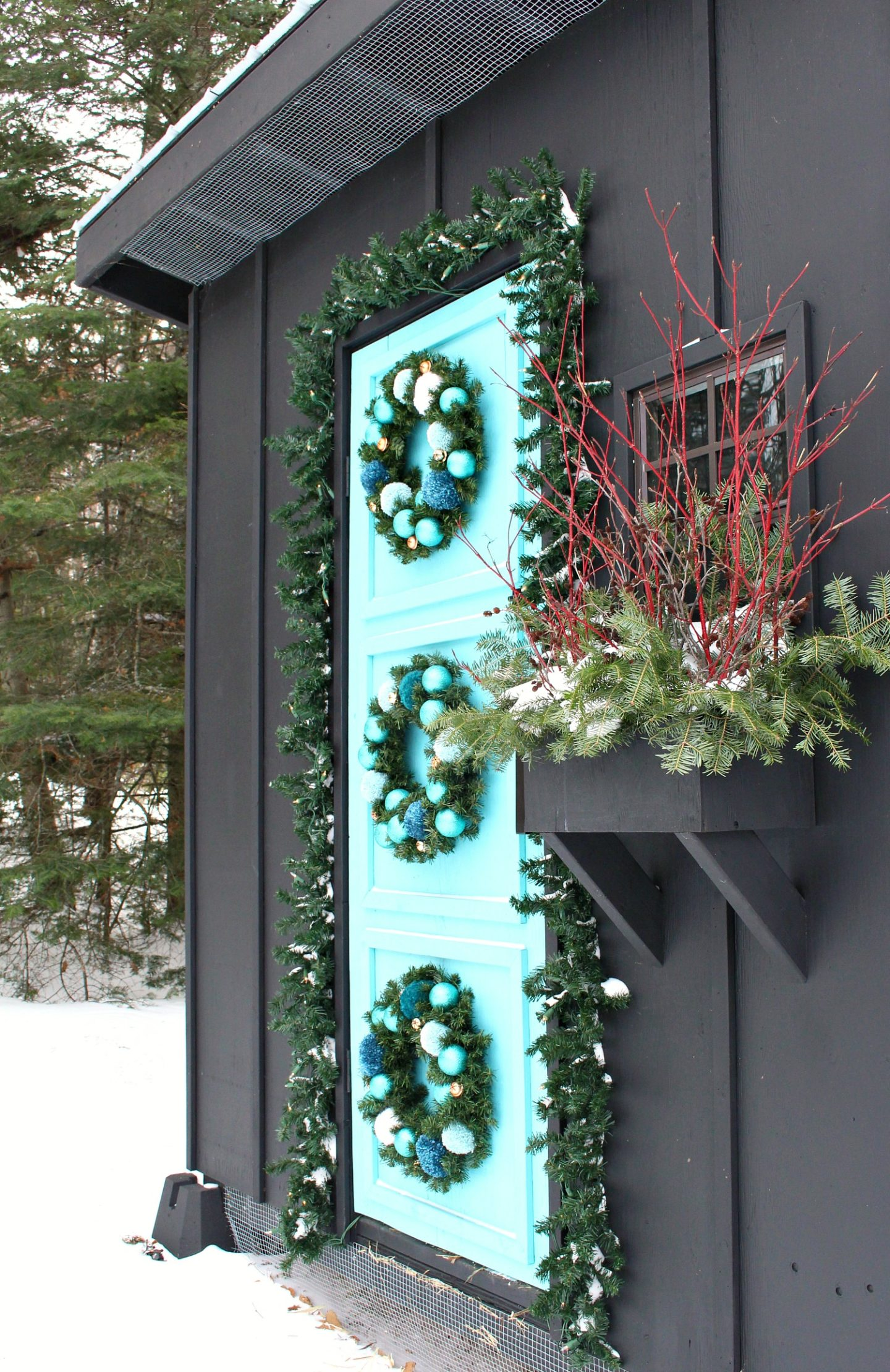 Three Wreaths Hung on a Door | Festive Holiday Coop Decor