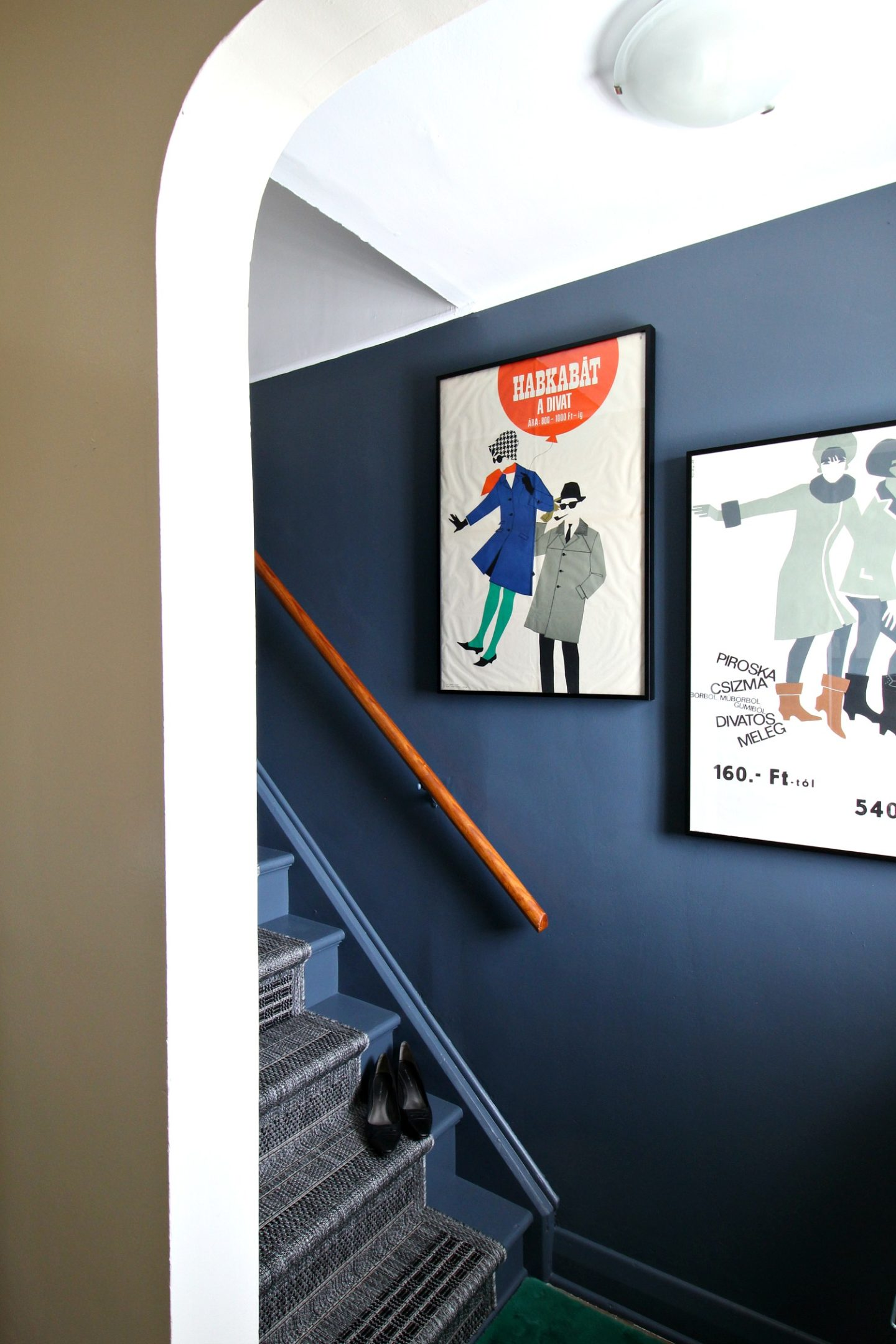 Vintage Entryway Decor with Mid-Century Posters and Dark Grey Walls