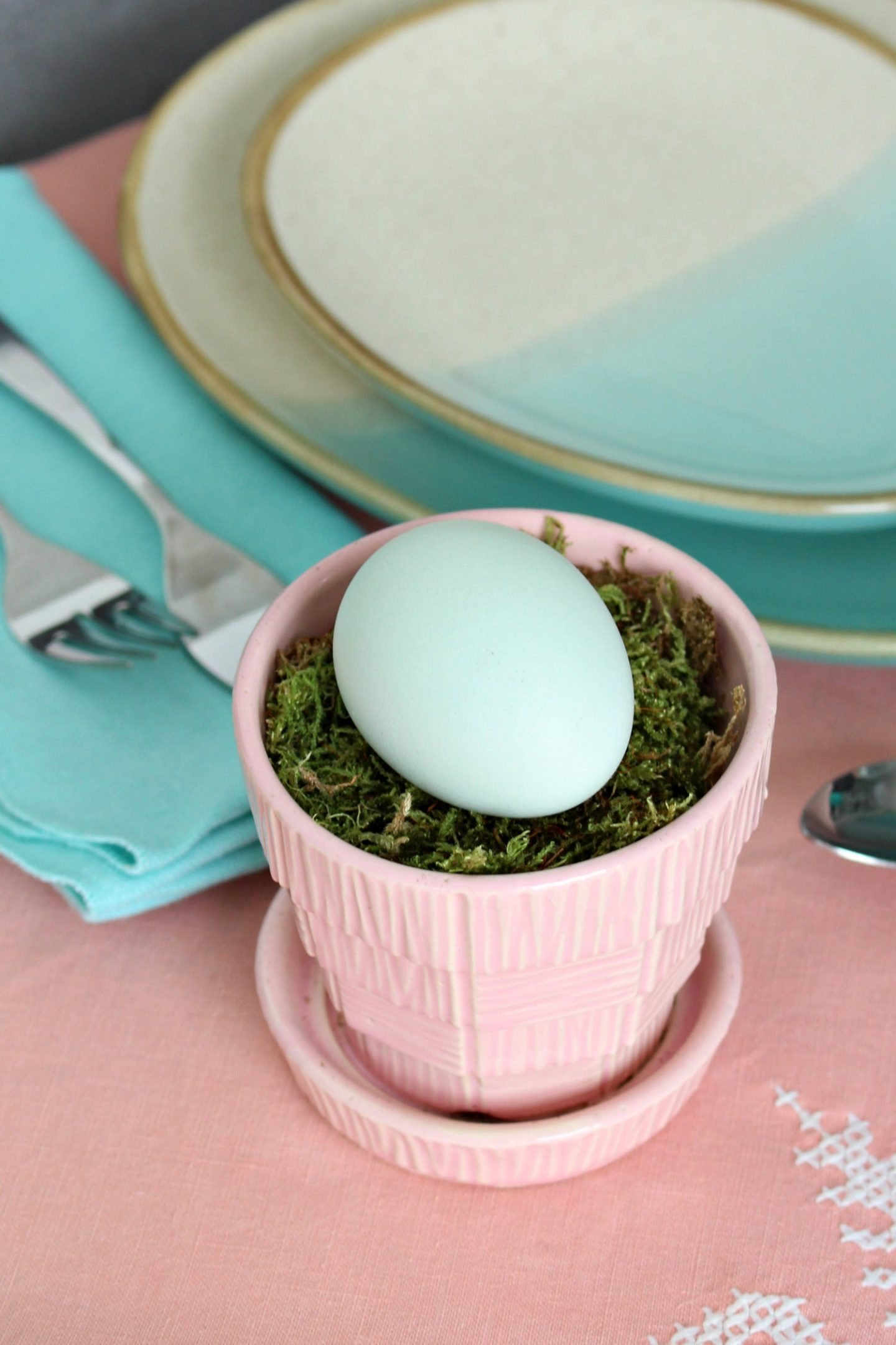 aqua egg in pink Mccoy pottery planter