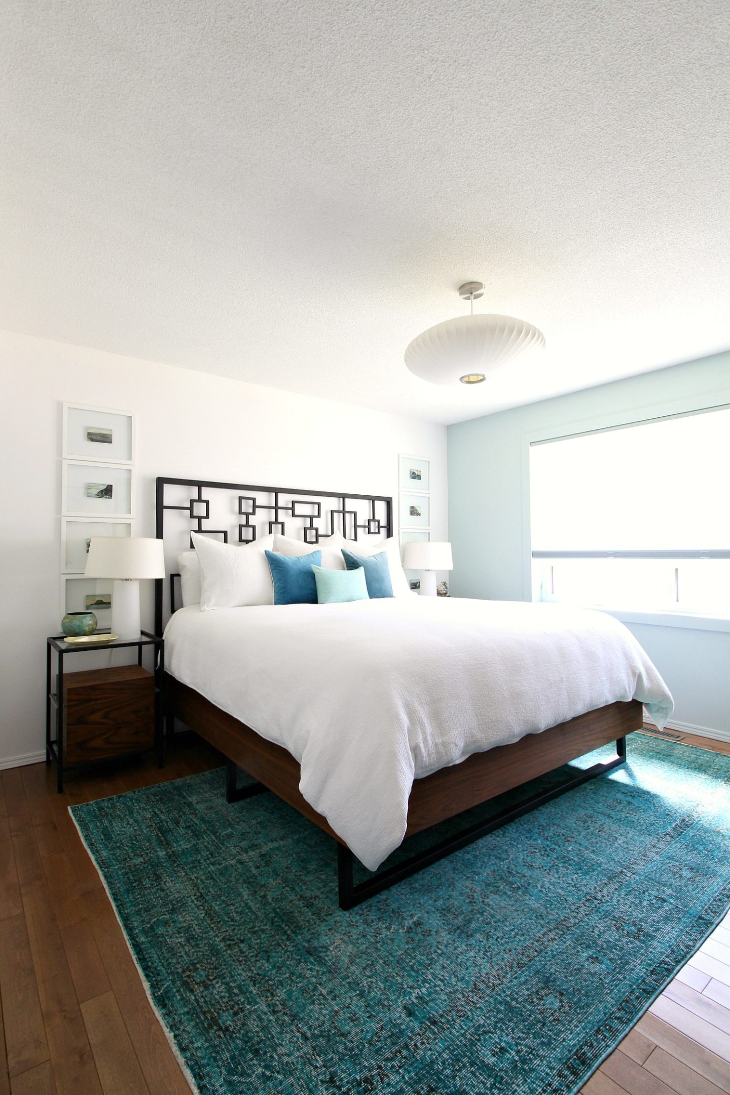 Coastal Bedroom with Overdyed Rug