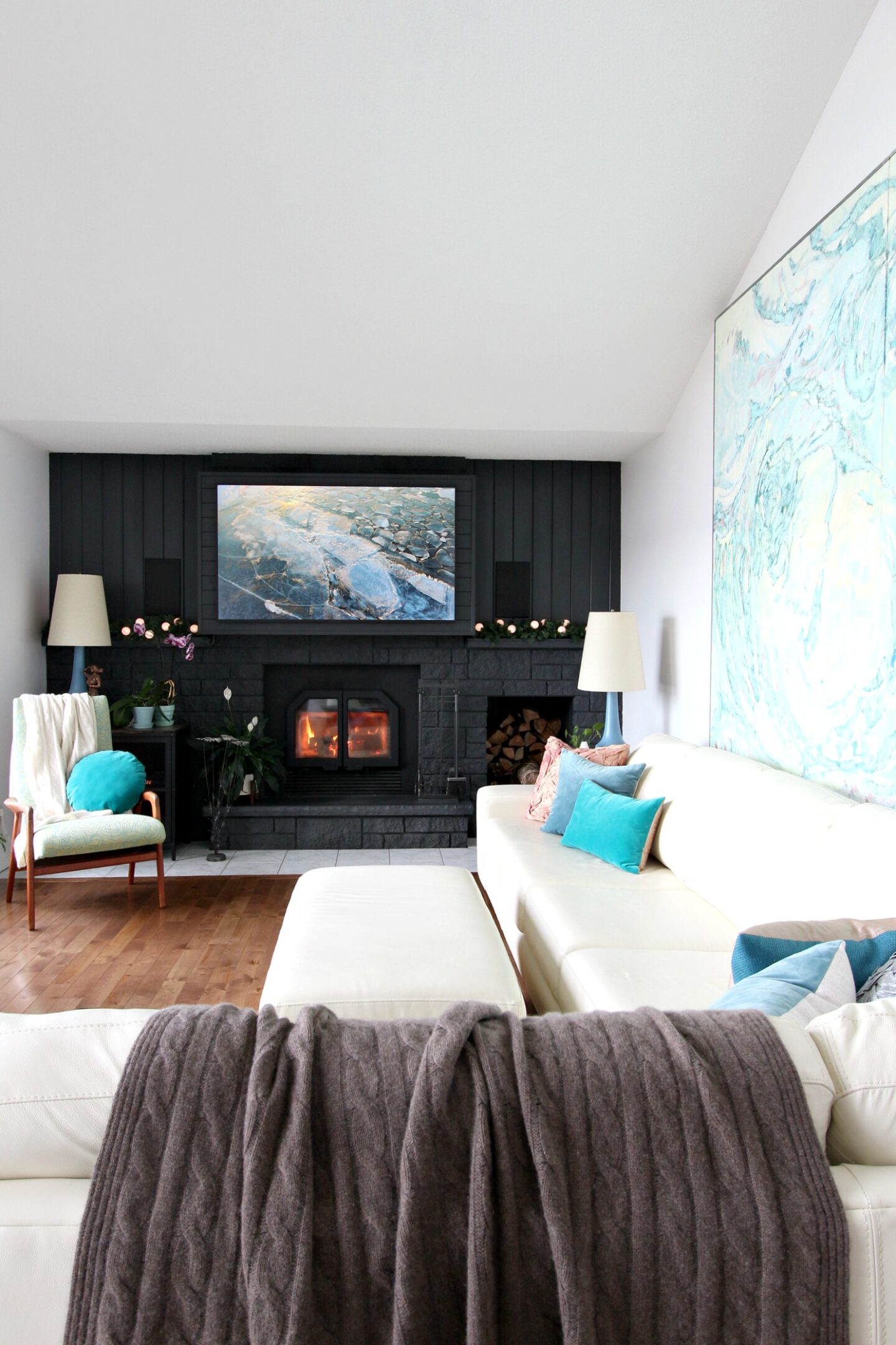 Black Fireplace with Pop of Color Artwork